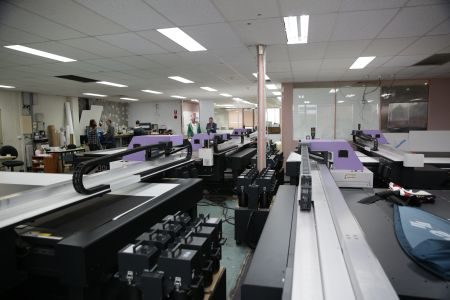 The bank of 13 Mimaki flatbeds that are in continuous use at Avon Graphics